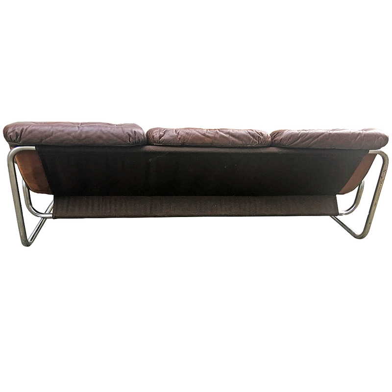 three-seat brown leather tufted sofa with tubular chrome frame, circa 1950s -1960s, designed by Johan Bertil Häggström