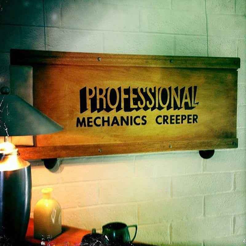 vintage wooden mechanics creeper