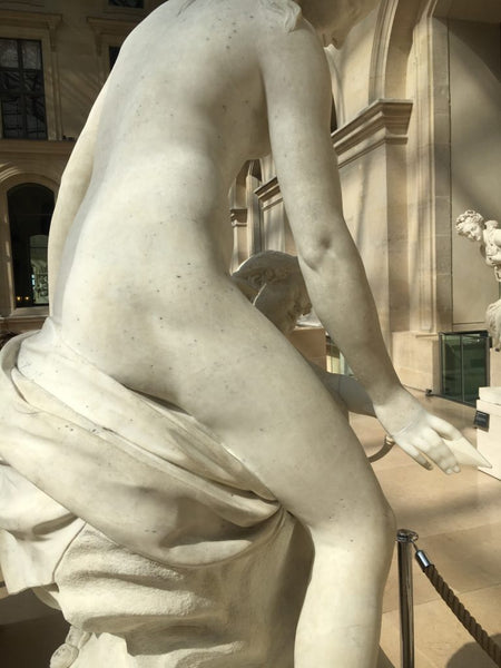 close up of the backside of a sculpture at the louvre