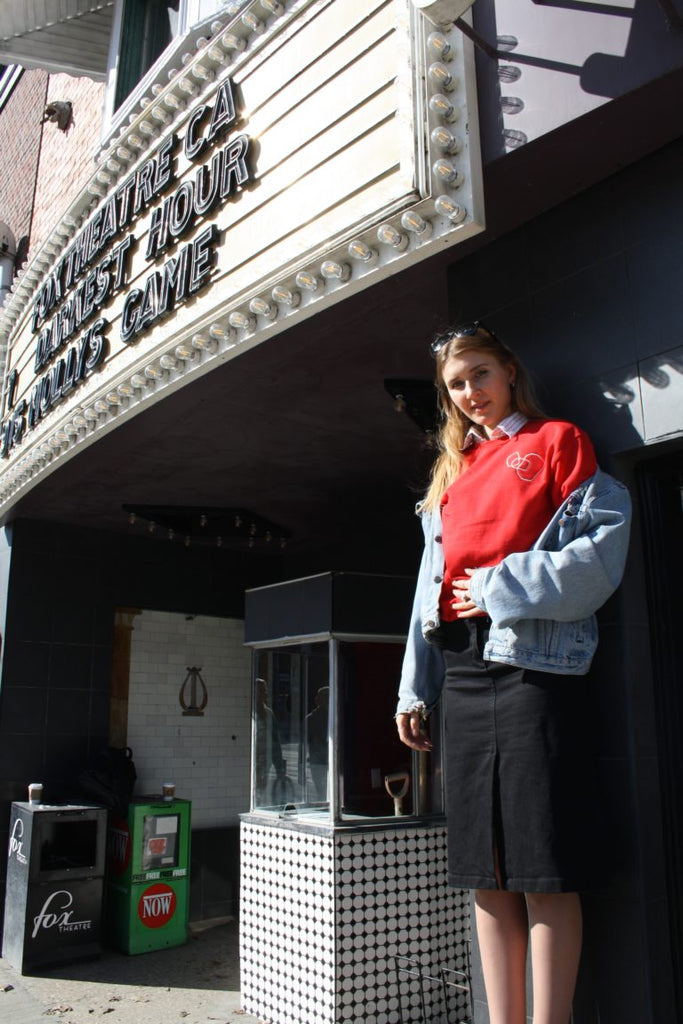 standing outside fox theatre in the red LYS sweater