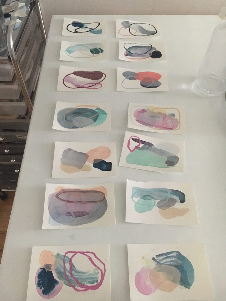two rows of 7 small paintings