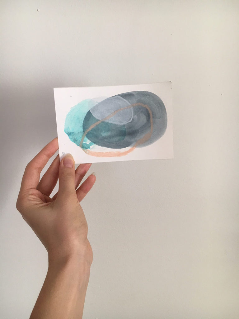 a small abstract painting with cool colours
