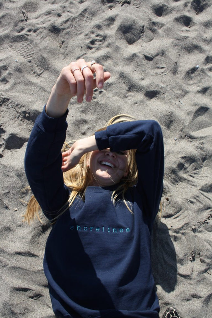 laughing while laying on the sand