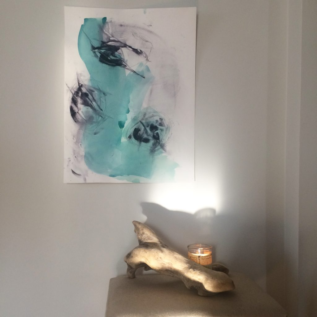 painting on a white wall with natural light streaming in