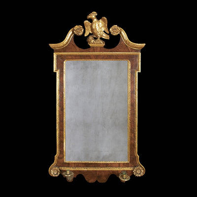 George II mahogany and gilt scroll top mirror with rosettes and sconce arms