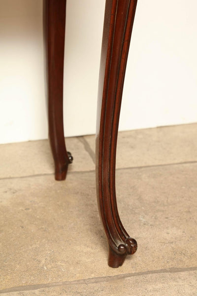 A fine English George III mahogany serpentine scroll foot card table.