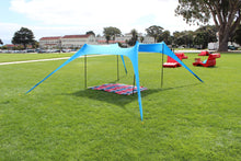 The SunBear Shade becomes a canopy with 4 poles and can also be set up on grass with corkscrew tent stakes