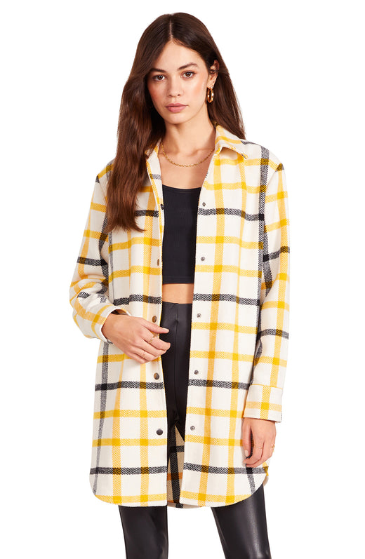 yellow white and black  buffalo plaid oversized coat has a snap front closure and snaps at the cuffs.