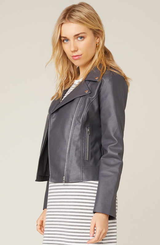 Side view of model wearing charcoal grey vegan leather jacket