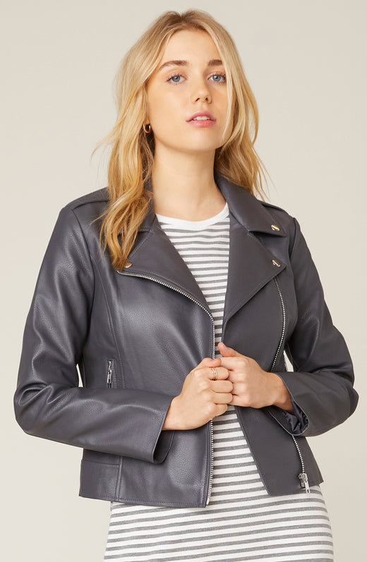 Model wearing charcoal grey vegan leather jacket