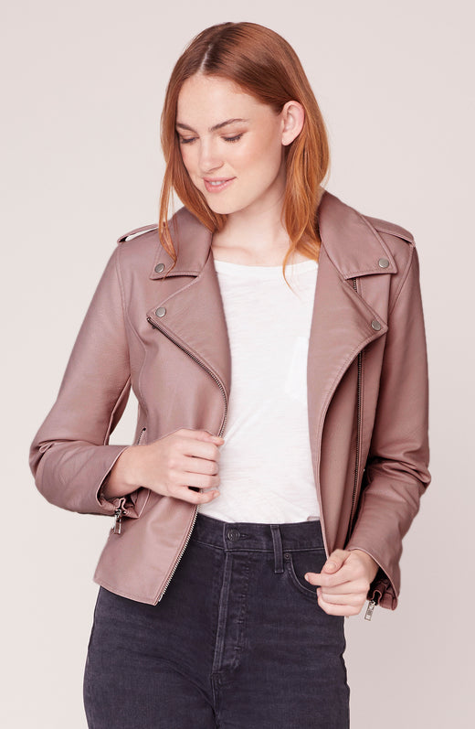 Model wearing mauve vegan leather moto jacket