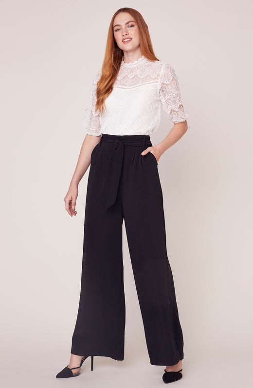 Model wearing wide leg black pants