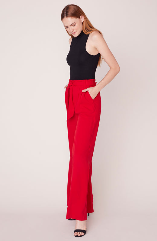 Model wearing red wide leg pants