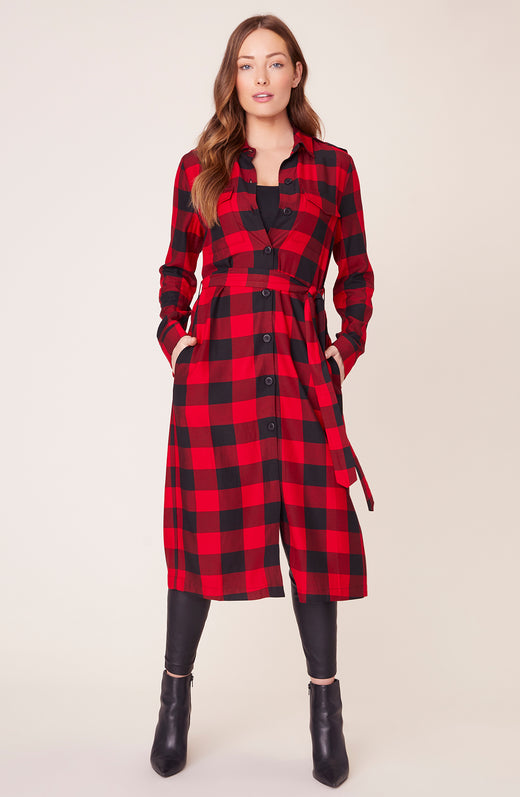Model wearing long buffalo plaid coat