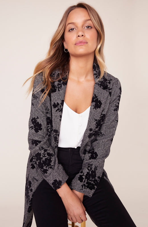 Model wearing grey floral jacket