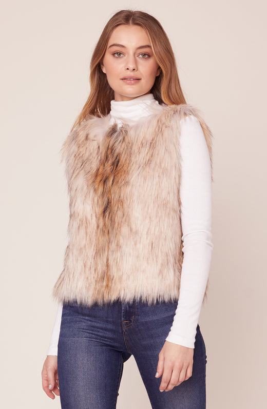Model wearing faux fur vest