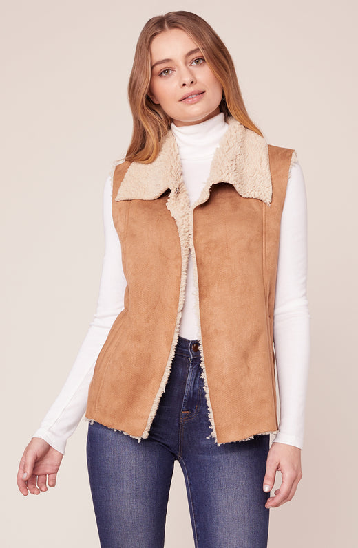 Model wearing faux suede and sherpa vest