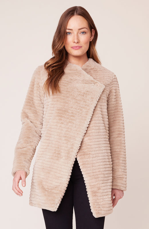 Model wearing tan faux fur jacket
