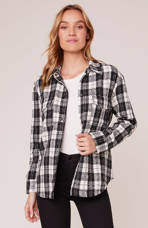 Model wearing Black and White plaid jacket