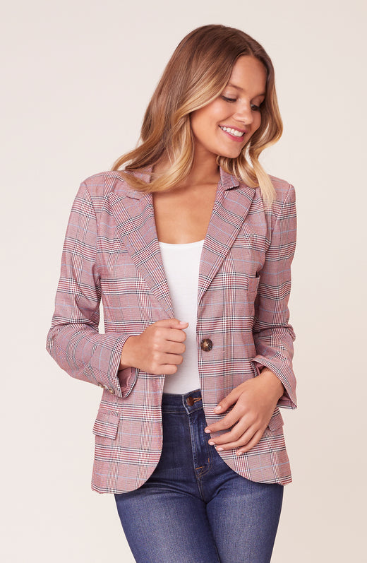 Model wearing red plaid blazer
