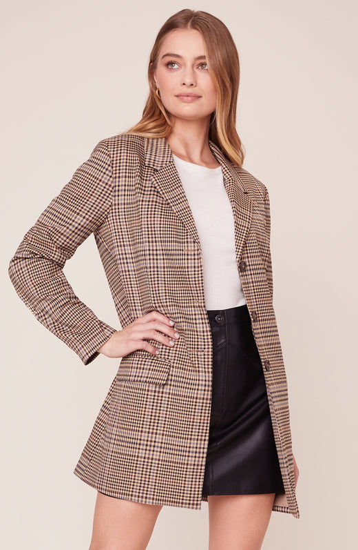 Model wearing brown long line plaid blazer