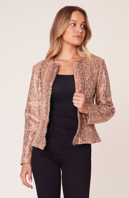 Model wearing snakeskin peplum jacket