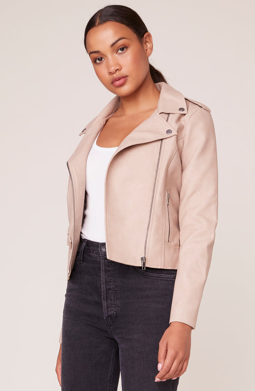 Model wearing tan colored vegan leather moto jacket