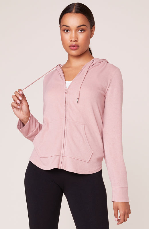 Model wearing super soft zipped hoodie in pink