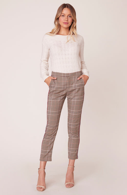Model wearing plaid trousers