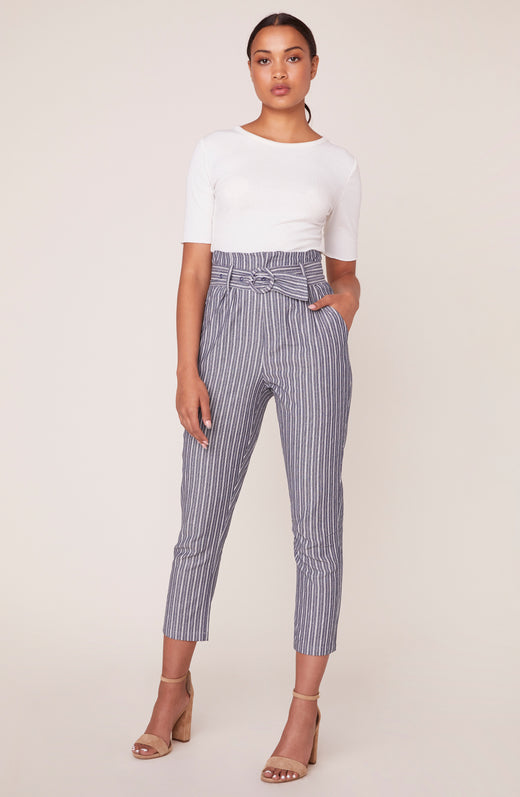 Model wearing high waisted striped pants