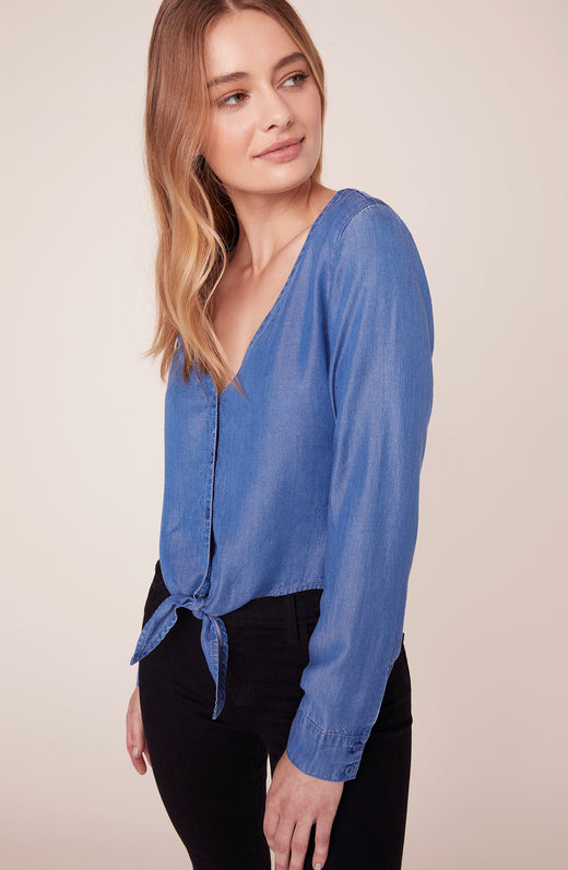 Model wearing long sleeve chambray top