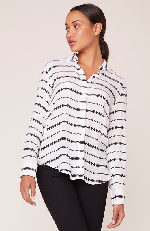 Model in long sleeve striped shirt