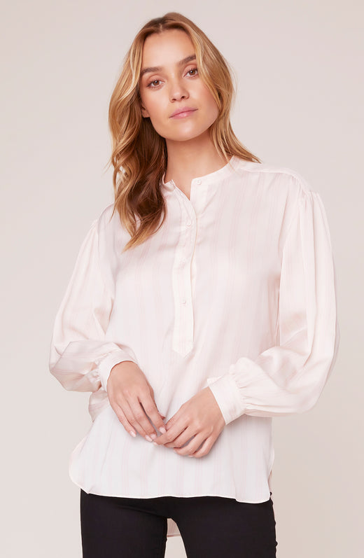 Model wearing silky long sleeve blouse