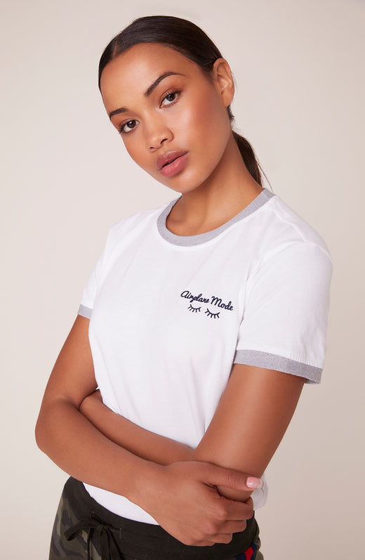 "Model wearing ""airplane mode"" embroidered ringer tee"