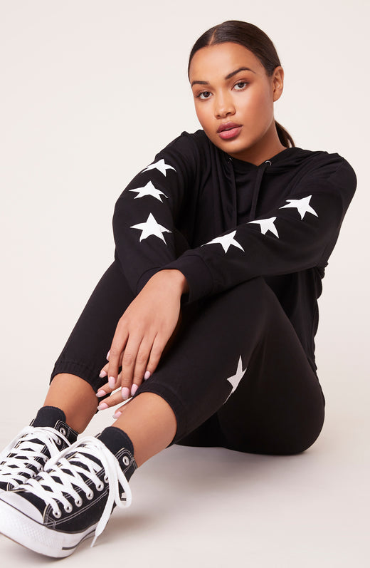 Model wearing super soft star printed hoodie