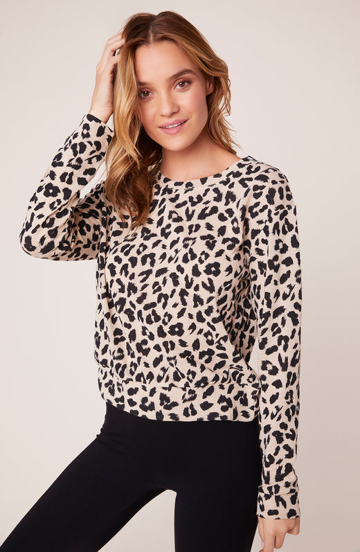 Model wearing super soft leopard printed sweater