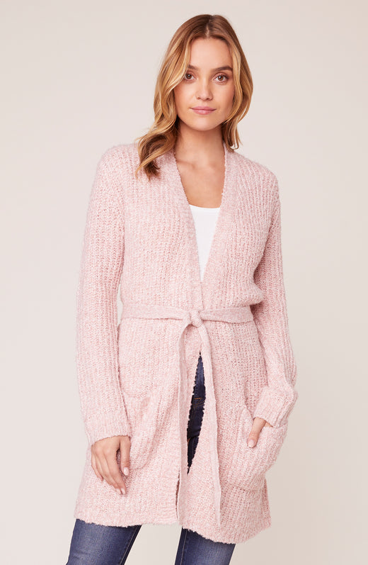 Model wearing pink duster cardigan sweater