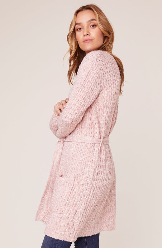 Side view of model wearing pink duster cardigan sweater