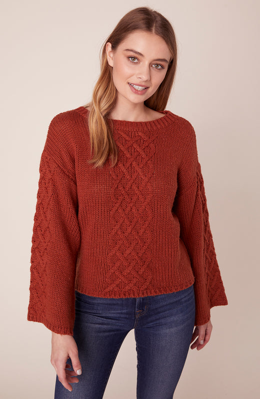 Model wearing allover cable knit sweater