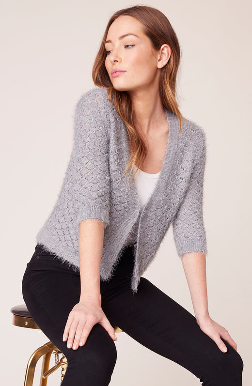 Model wearing grey cardigan with short sleeves