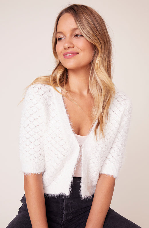 Model wearing Ivory cardigan with short sleeves