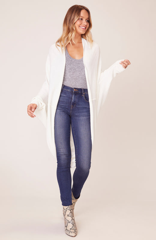 Model wearing ivory cocoon cardigan