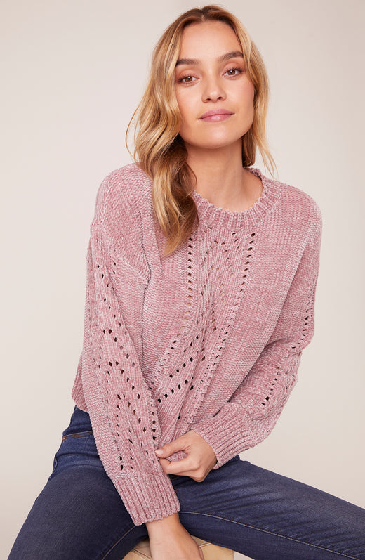 Model wearing super soft drop needle sweater in pink