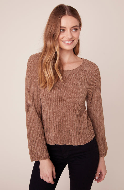Model wearing camel sweater