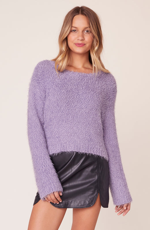 Model wearing purple fuzzy sweater