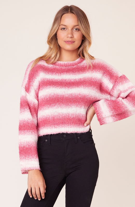 Model wearing striped pink sweater