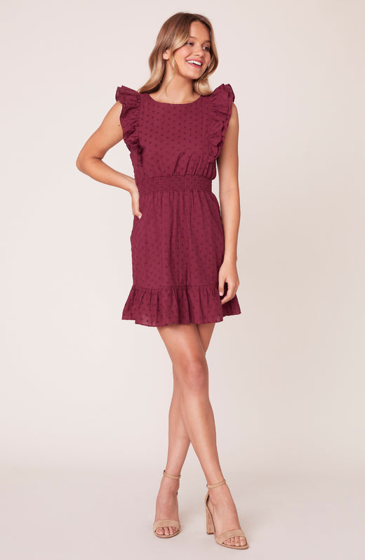 Model wearing dress with ruffle sleeves