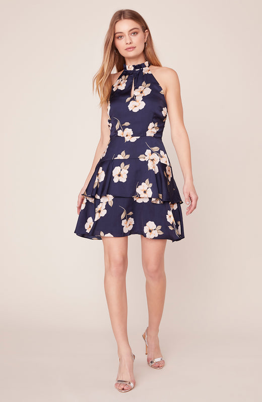 Model wearing high neck floral dress