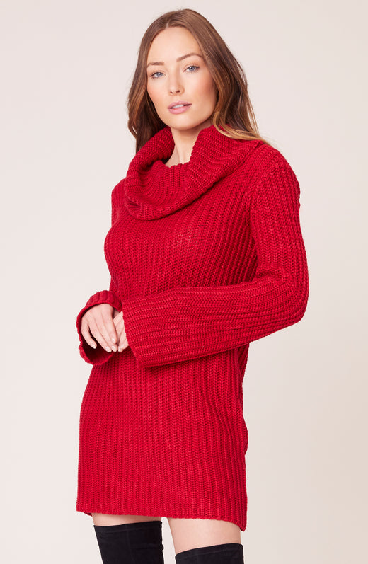 Model wearing red cowl neck sweater dress