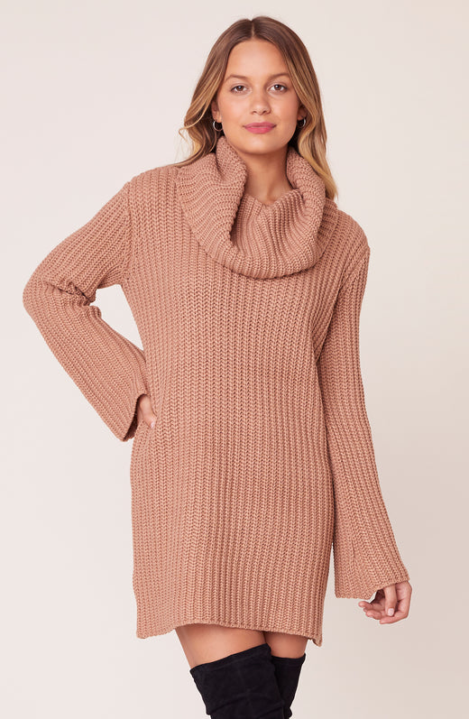 Model wearing tan cowl neck sweater dress